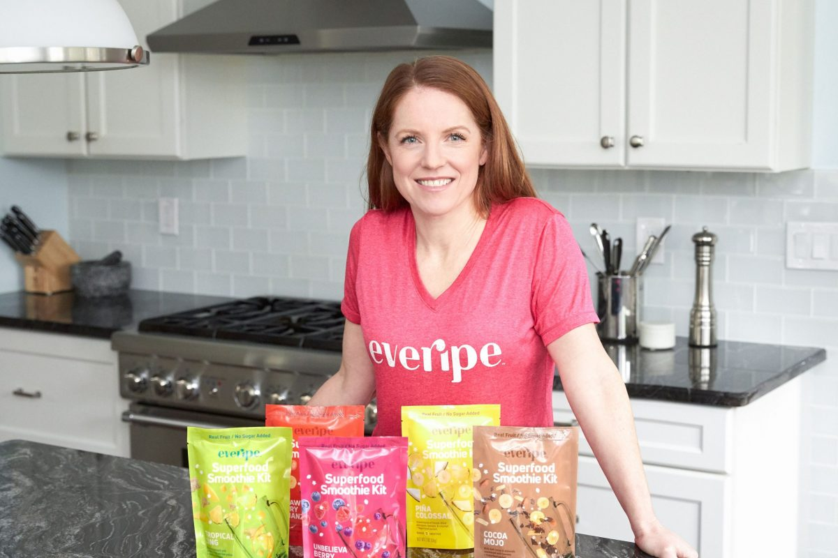 Cofounder-Kerry-in-kitchen-with-smoothie-packaging-1-scaled